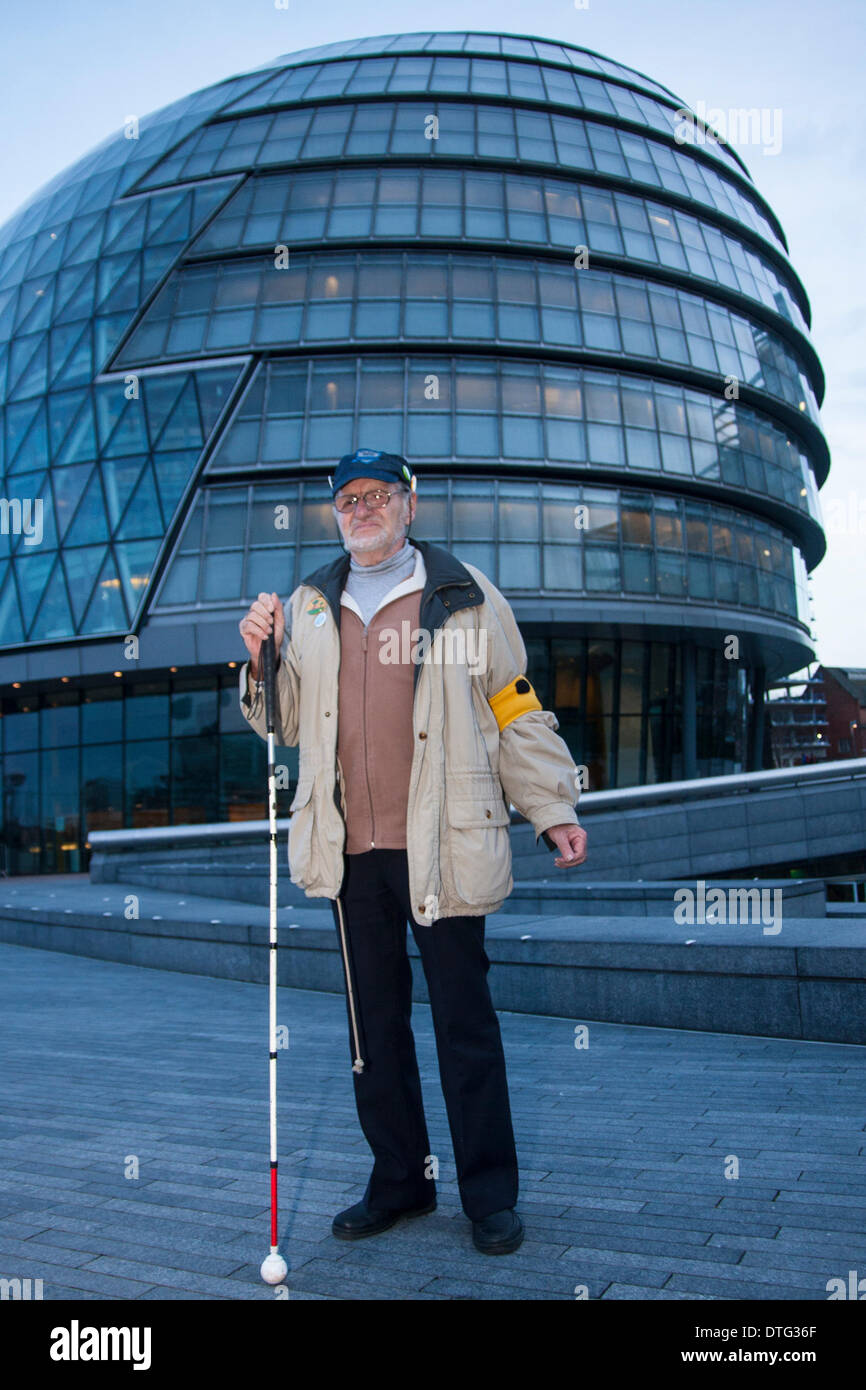 London, UK. 17th Feb 2014. . Dietrich Wagner, blinded by Water cannons in Germany arrives at City hall to support the campaign against Mayor Boris Johnson's plans to bring in water cannons to subdue street demonstrations. Credit:  Paul Davey/Alamy Live News - Stock Image