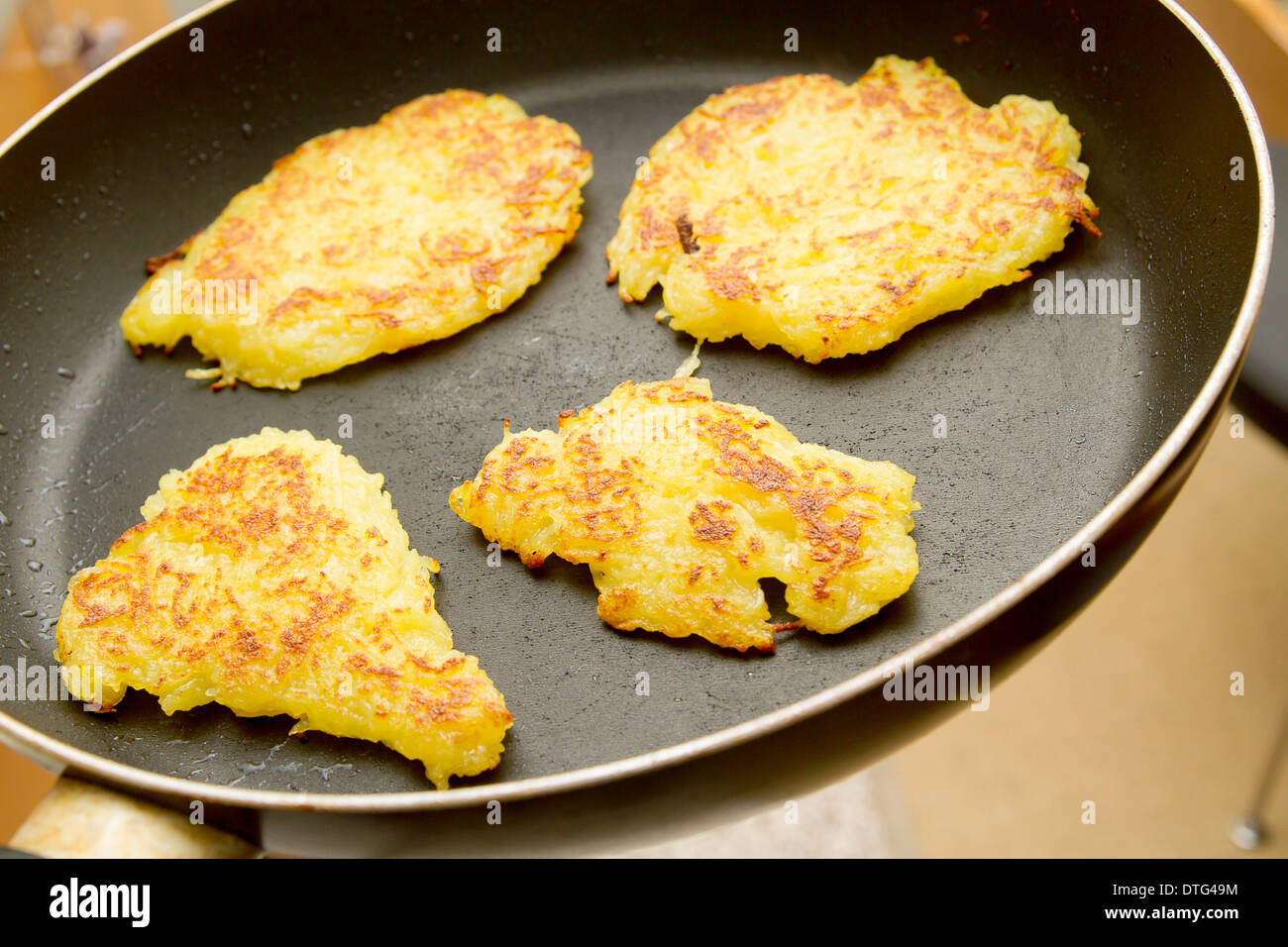 potato fritter in a pan - Stock Image