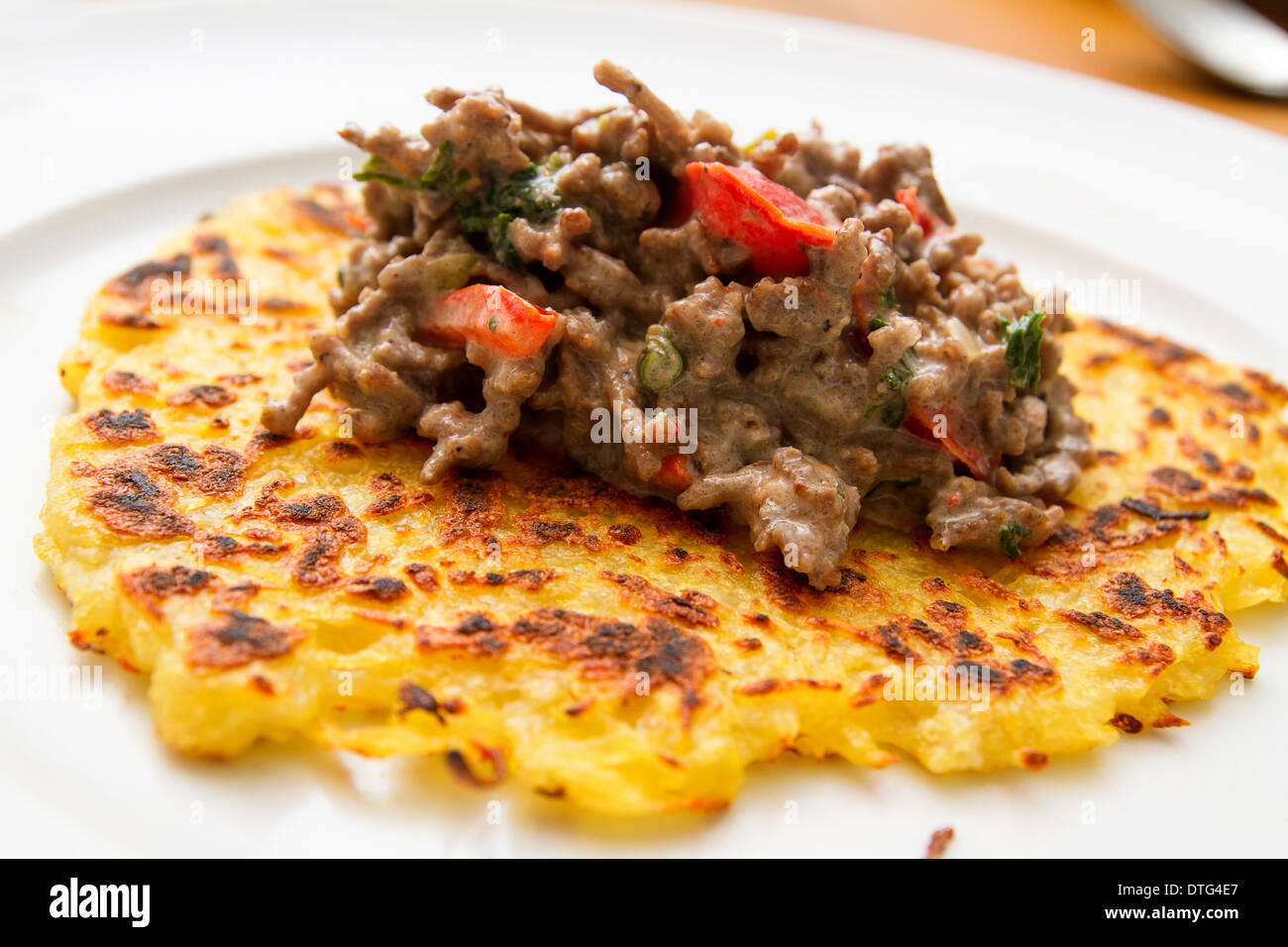 potato fritter with meat sauce Stock Photo
