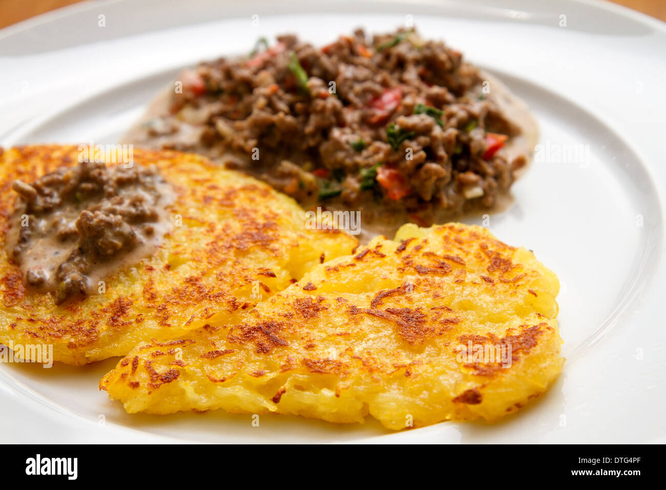 potato fritter with meat sauce - Stock Image