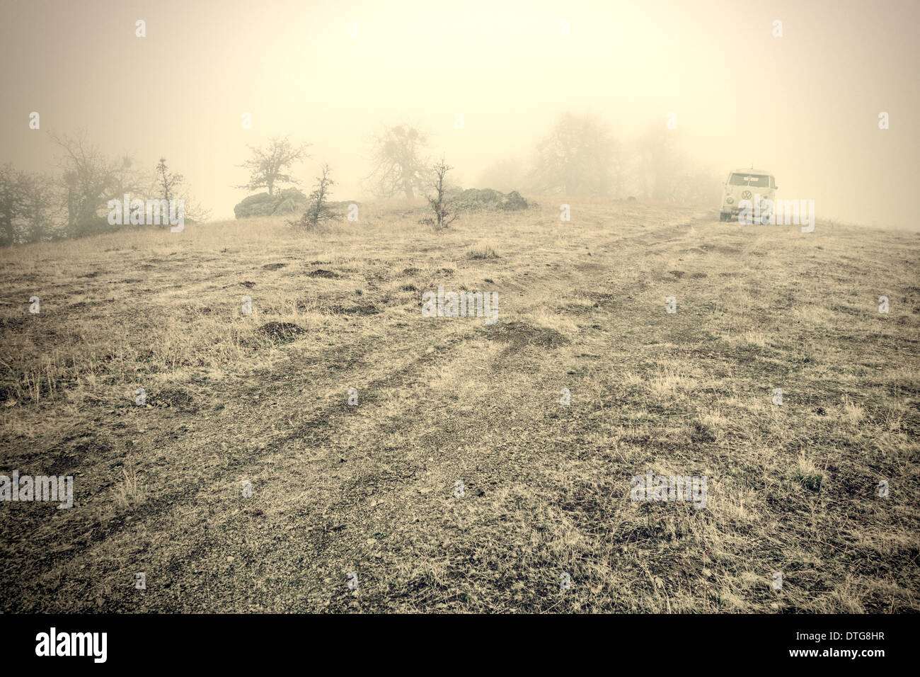 Vintage VW bus in fog with textures for a retro look. - Stock Image