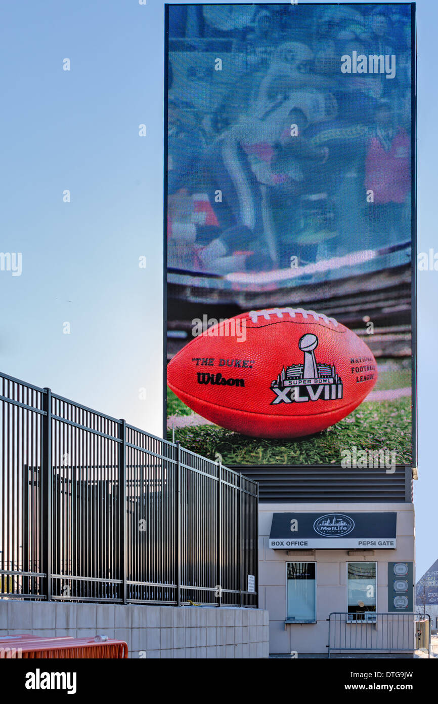 Metlife Stadium Box Office with an illuminated billboard of 'The Duke' Super Bowl XLVIII football advertising - Stock Image