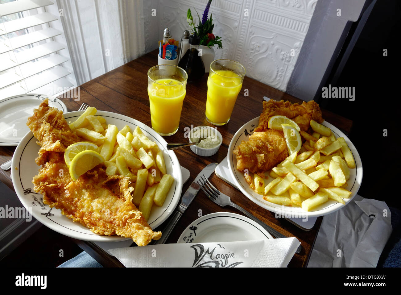Fish and chips for two at a window table at the famous Magpie Café in historic  Whitby North Yorkshire England UK - Stock Image