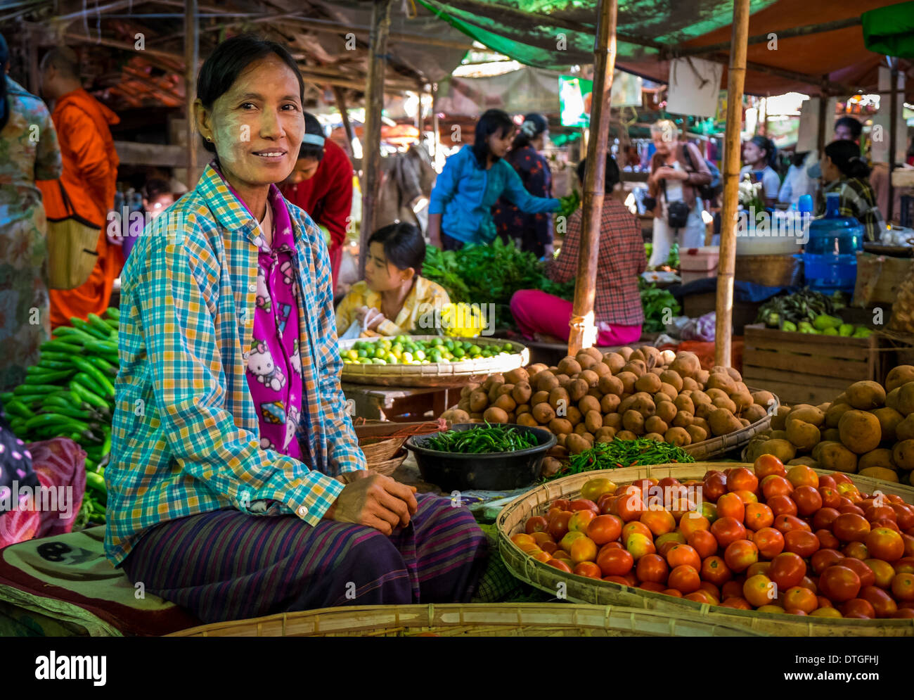 Woman selling vegetables in the Nyaung U market close to Bagan in Myanmar - Stock Image