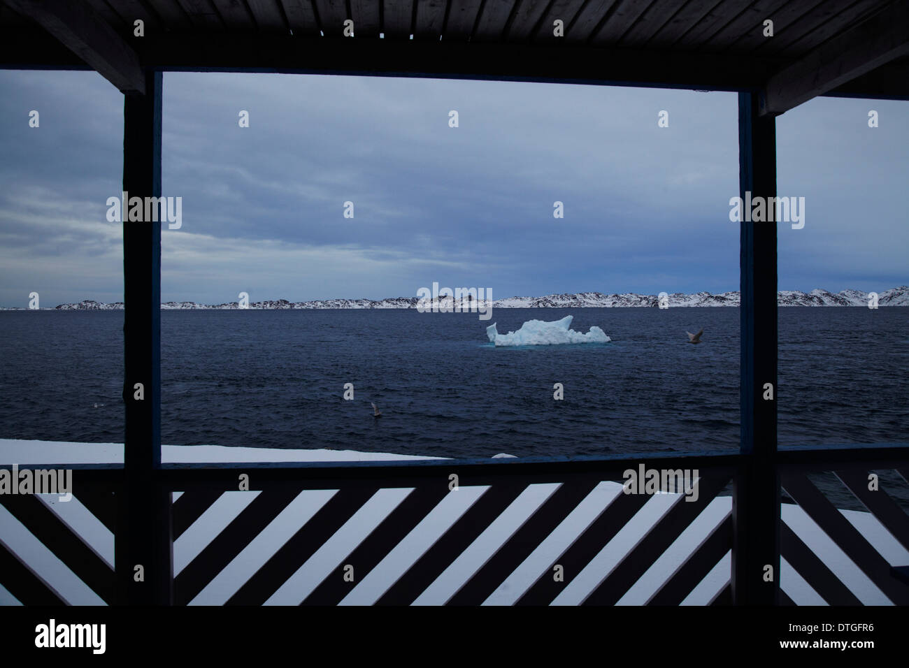 An Iceberg drives out to the Atlantic sea outside Nuuk City. Greenland - Stock Image