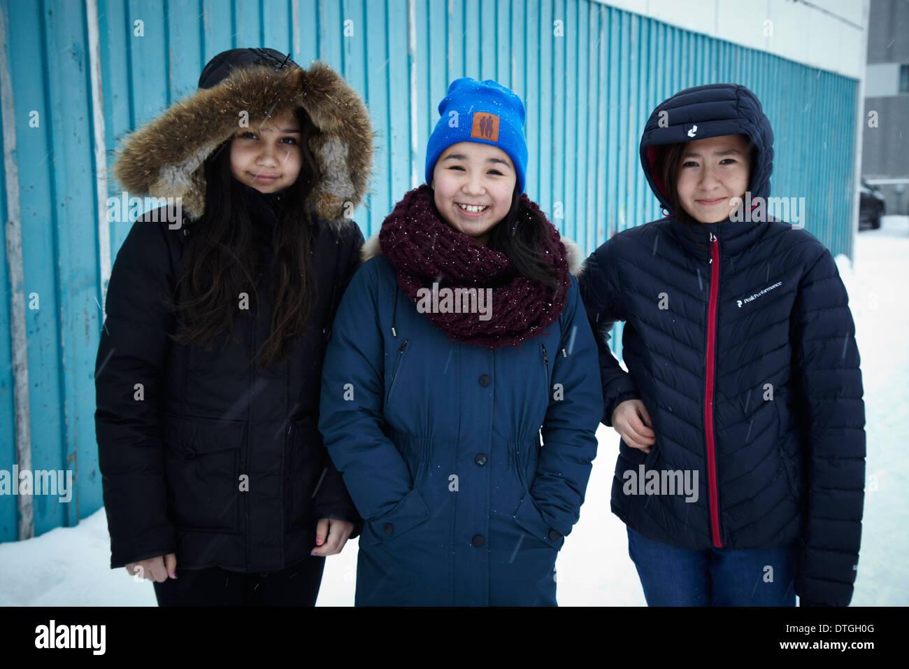 Three Greenlandic (Inuit) girls outside Nuuk shopping center in Greenland - Stock Image