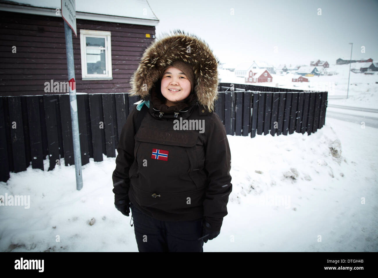 A young Inuit girl waiting for the bus in Nuuk center. - Stock Image