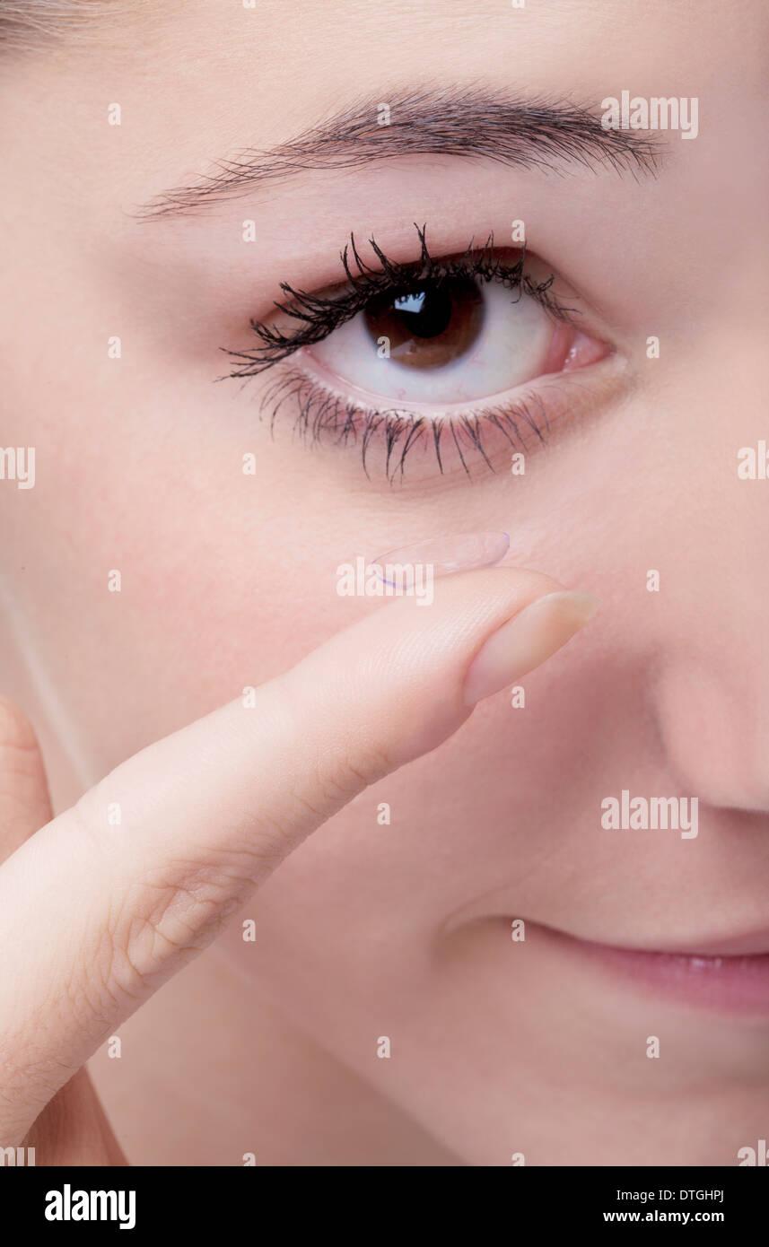 teenage girl,contact lens - Stock Image
