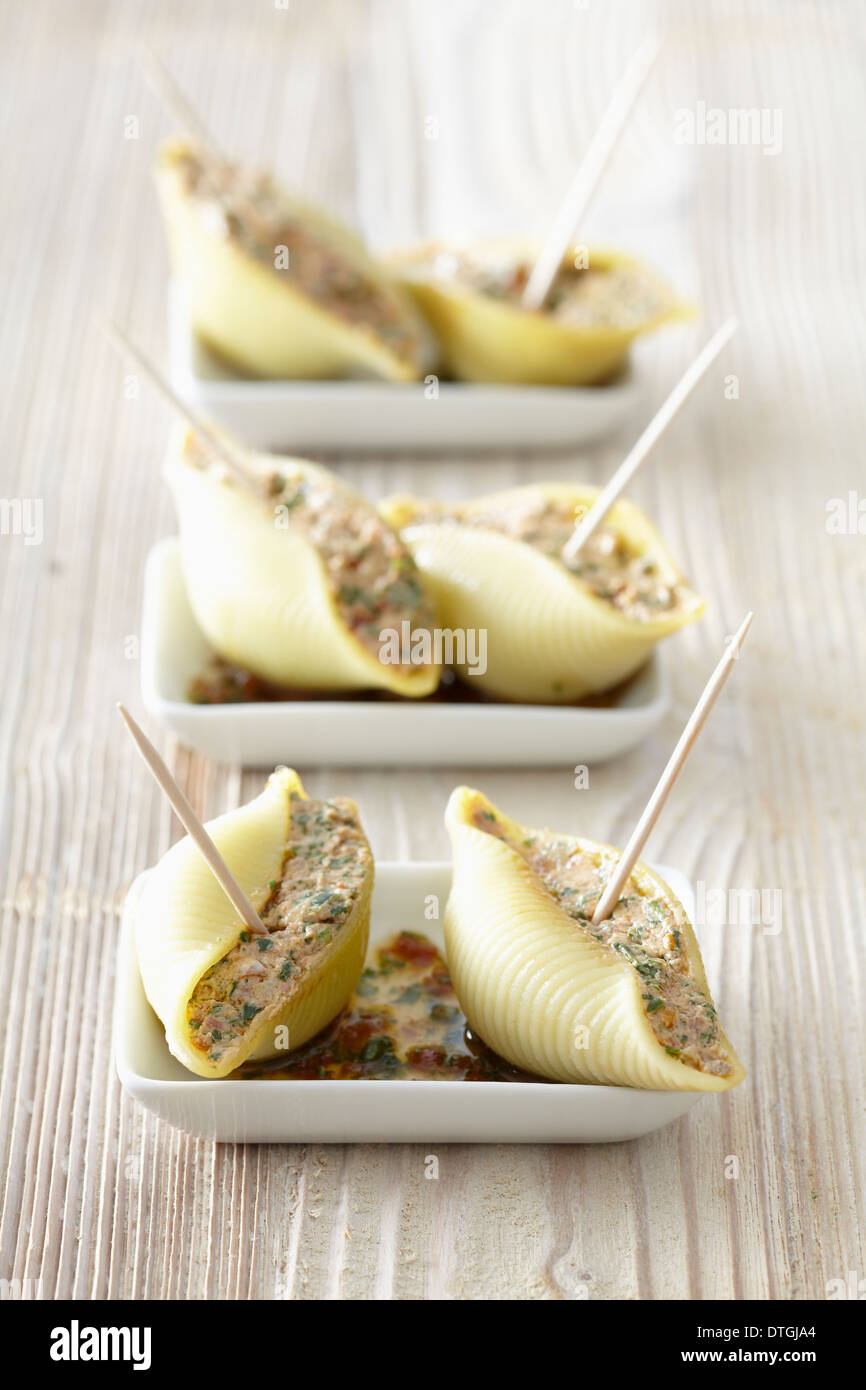 Conchiglie stuffed with fromage frais,sun-dried tomatoes and rocket lettuce Stock Photo