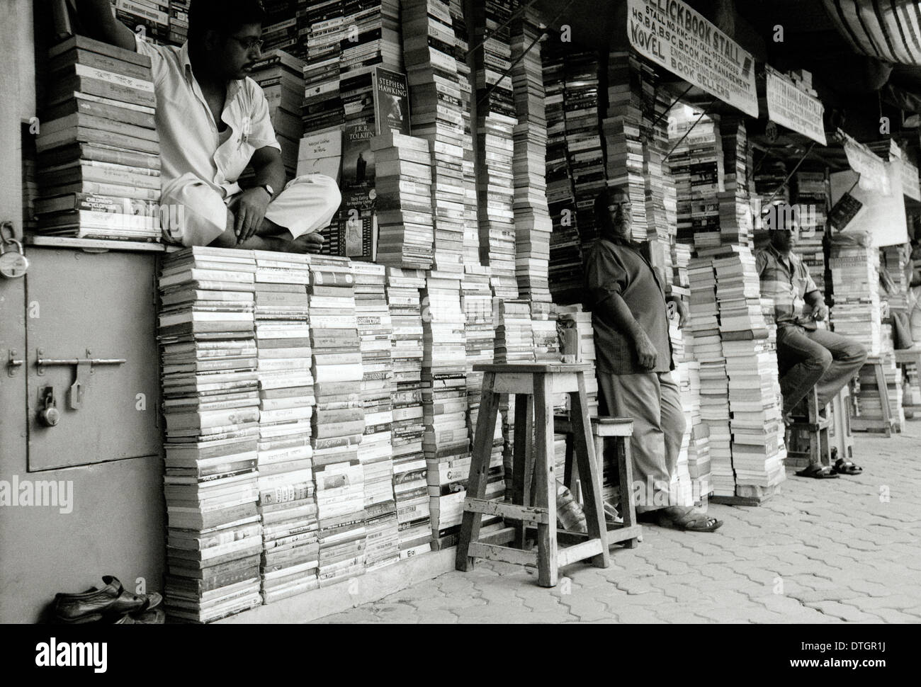 Book seller in College Street in Kolkata Calcutta in West Bengal in India in South Asia. Book Market Shop City Knowledge Sellers Intellectual Travel - Stock Image