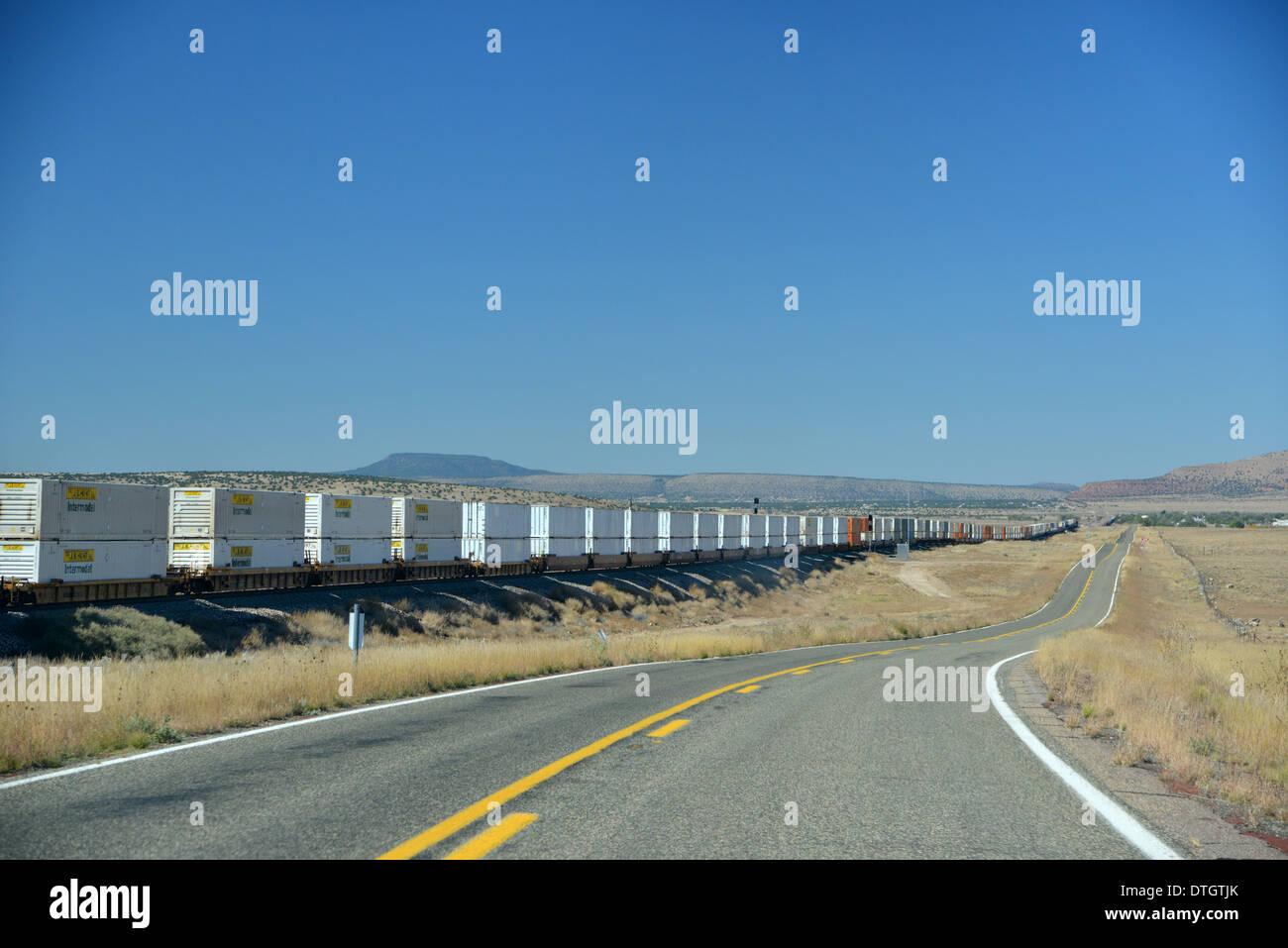 route 66, arizona, usa. long road runs alongside a goods train on