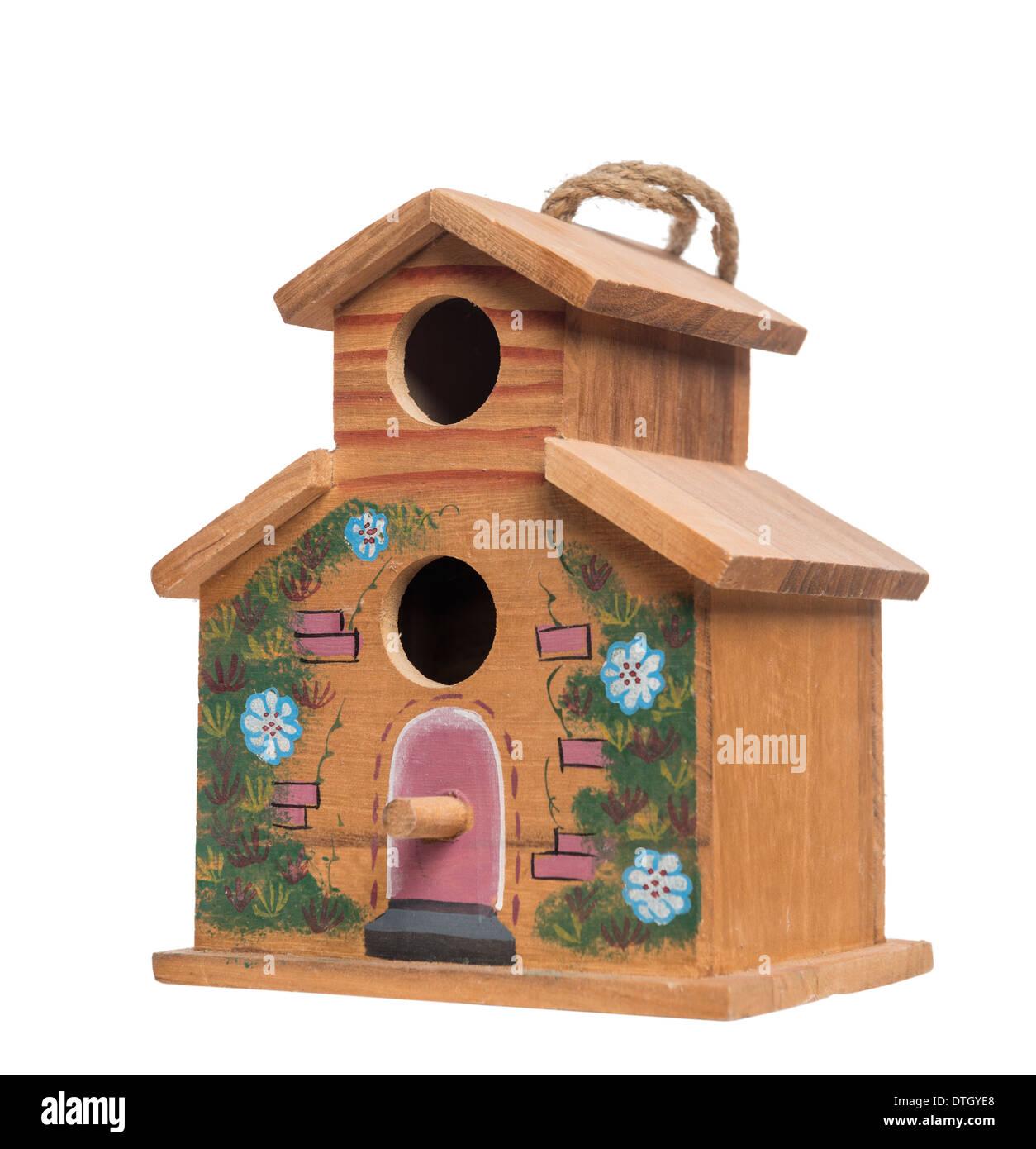 Birdhouse against white background - Stock Image