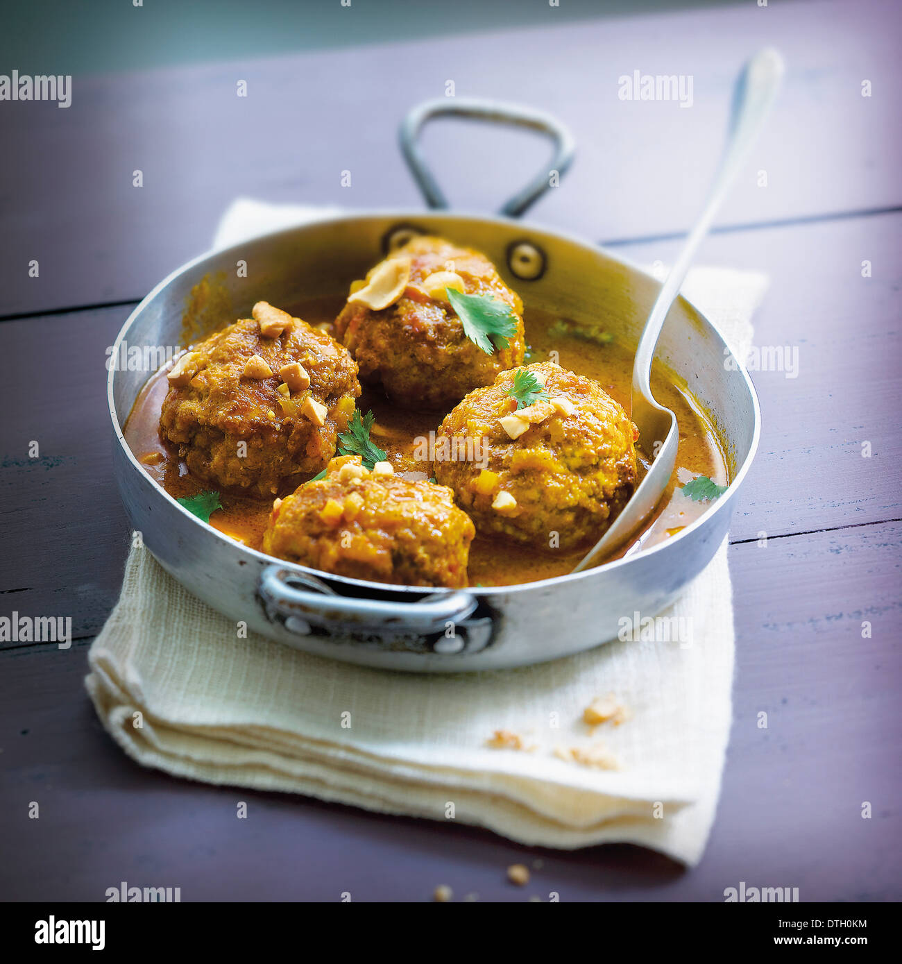 Curried pork meatballs - Stock Image