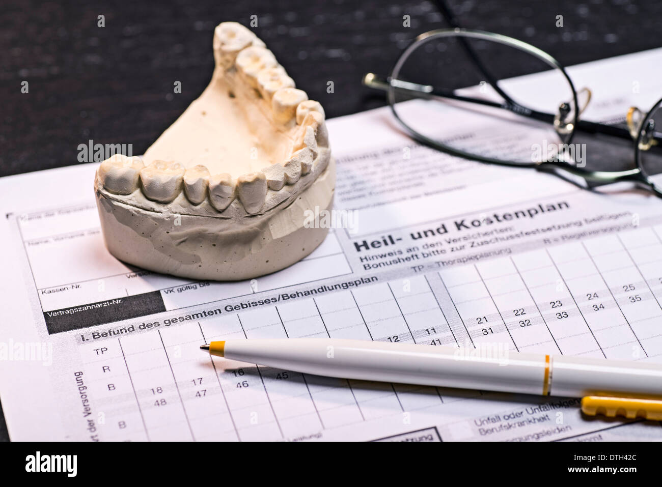 Treatment and cost plan for dental prostheses. - Stock Image