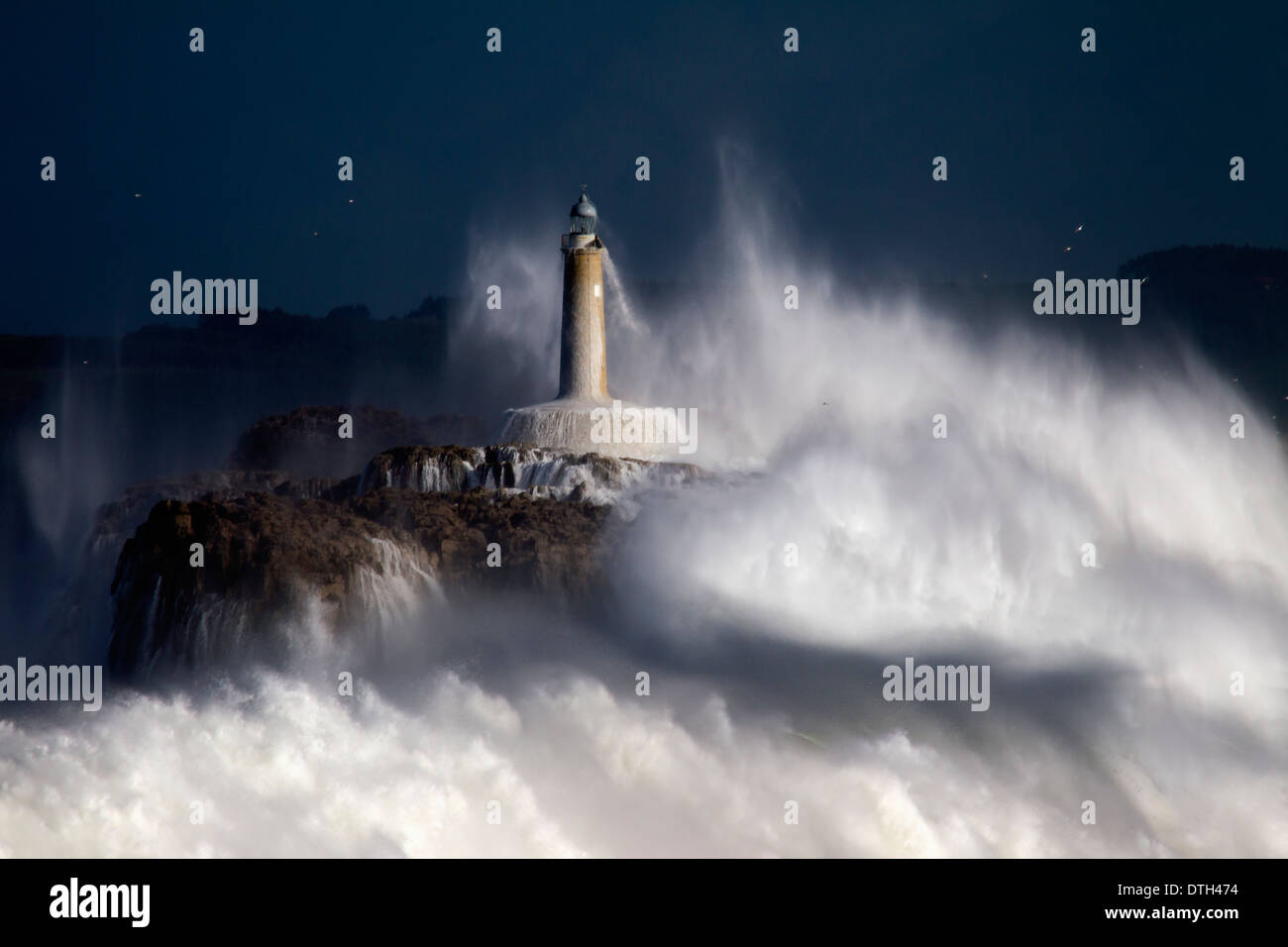 The Mouro island lighthouse in the big storm. - Stock Image