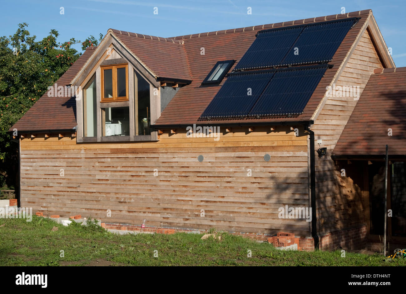 Solar thermal evacuated tubes on roof of barn Mickleton UK Stock Photo