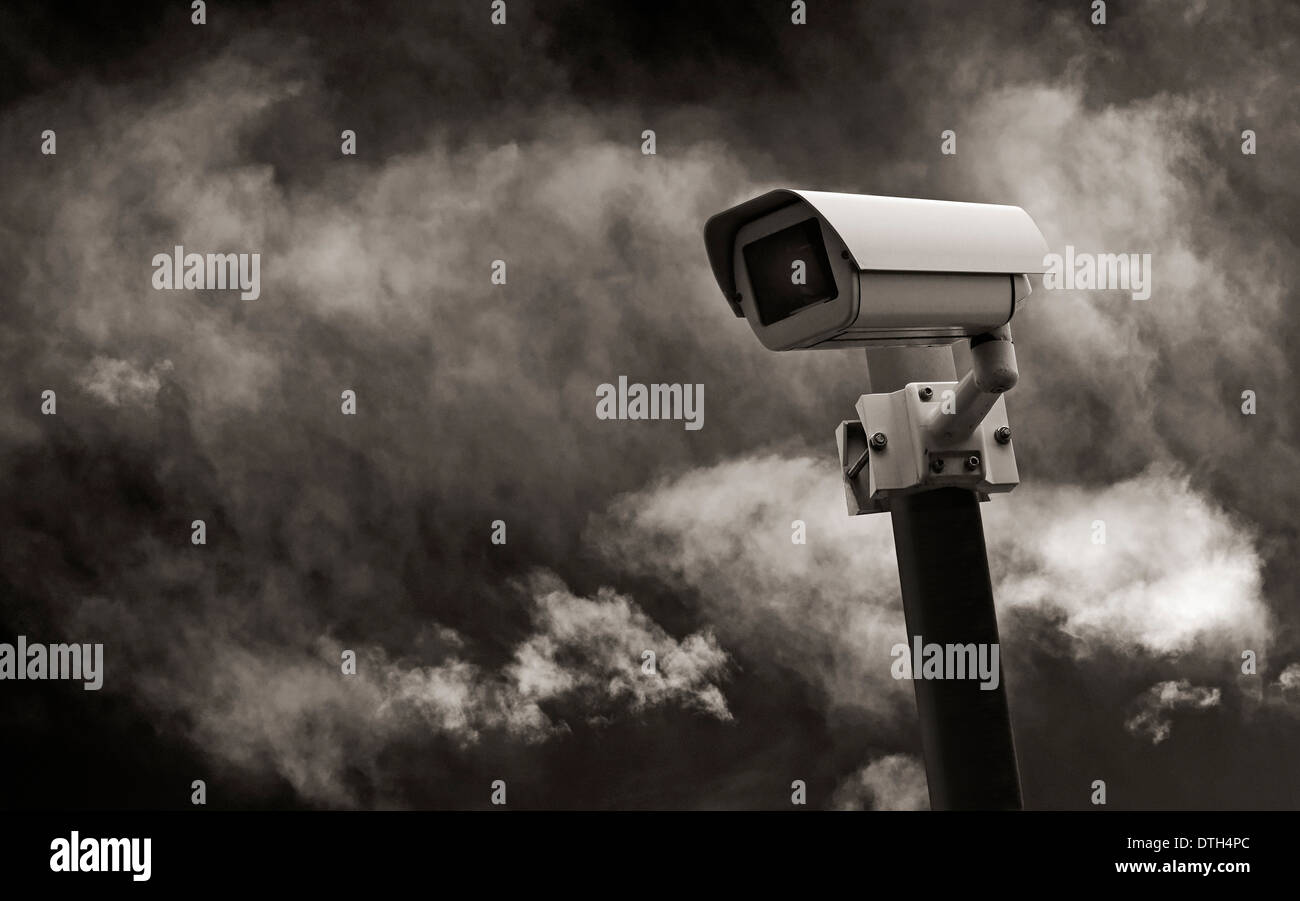 Surveillance camera in front of dramatic sky. - Stock Image