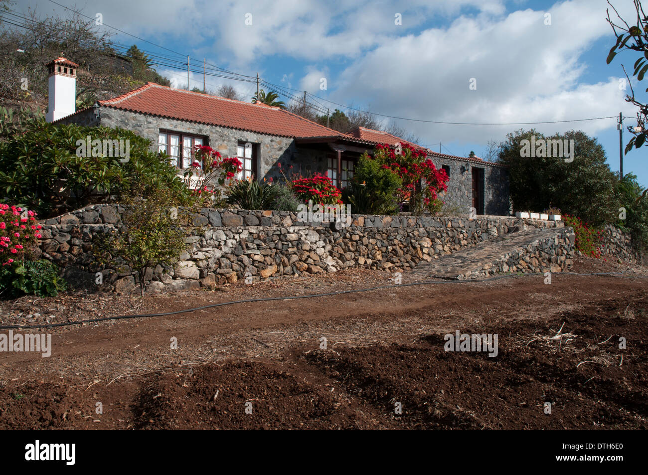 Rural buildings on La Palma are often constructed with dry stone walls. Refurbished many of them are now used as holiday homes. - Stock Image