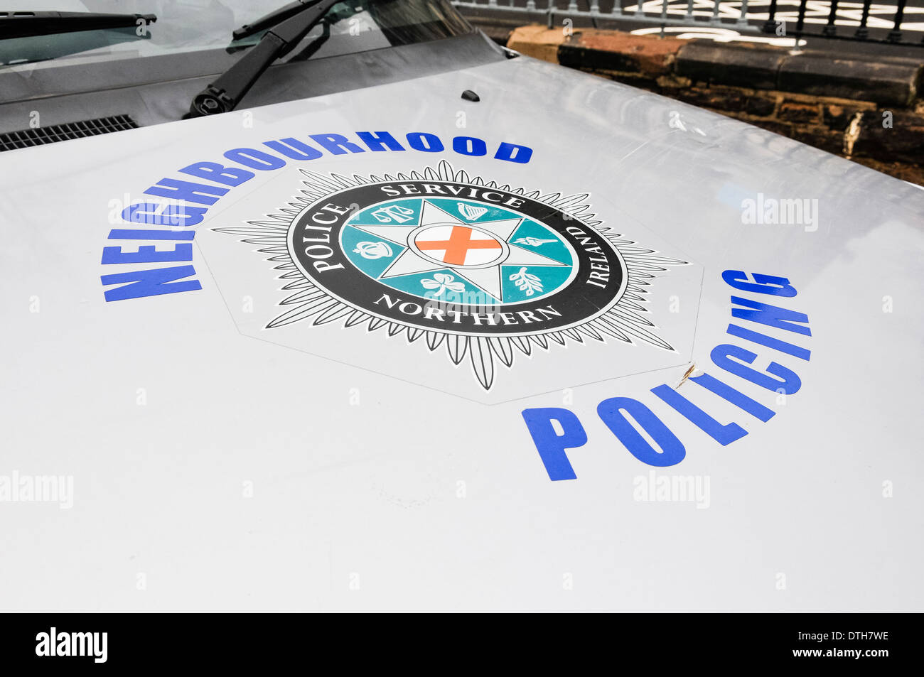 Police Service of Northern Ireland Neighbourhood Policing logo on the bonnet of a patrol car - Stock Image