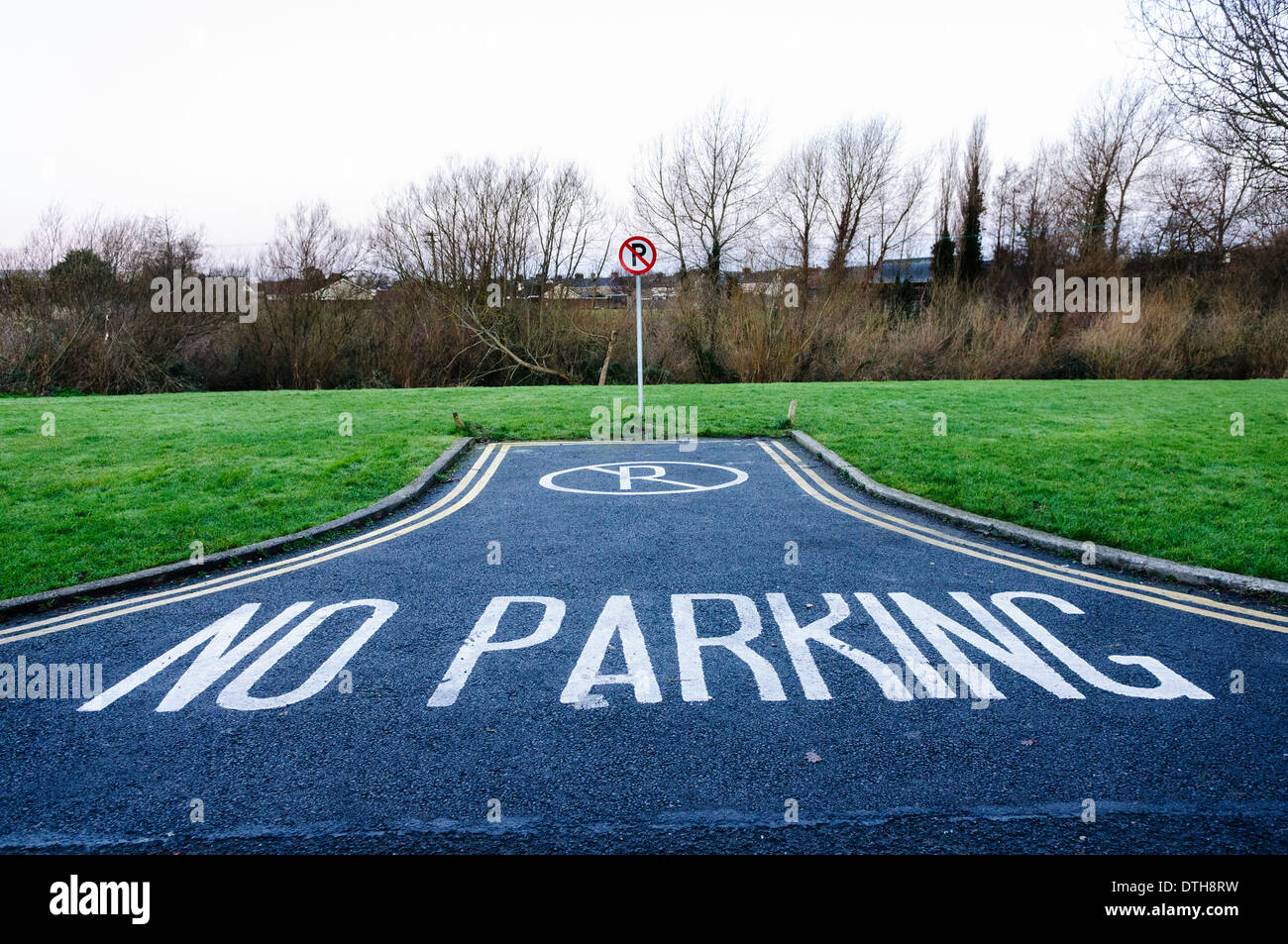 No parking sign and road marking - Stock Image
