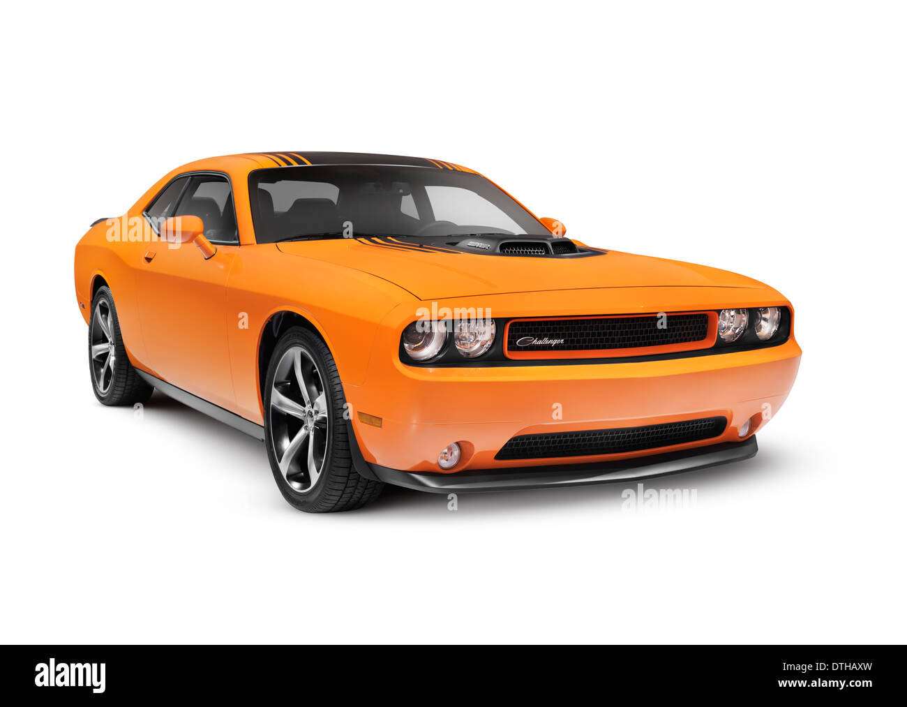 Orange 2014 Dodge Challenger muscle car isolated on white background with clipping path - Stock Image