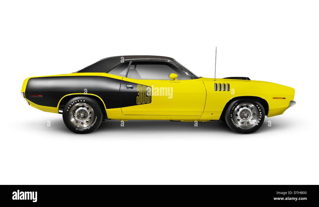 Yellow 1972 Dodge Challenger retro sports car side view isolated on white background with clipping path - Stock Image
