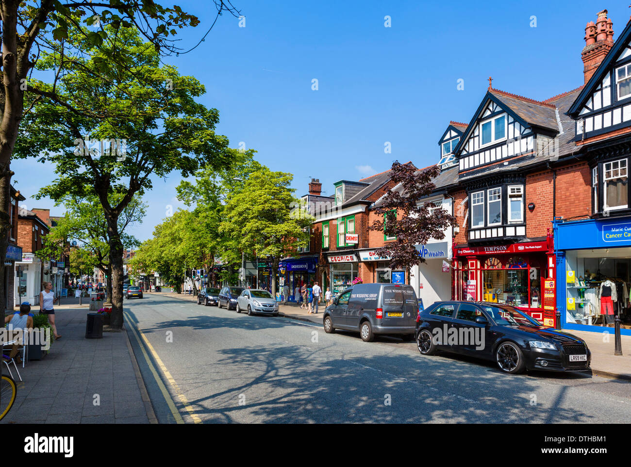 Shops on the High Street ( London Road ) in the village centre, Alderley Edge, Cheshire, England, UK - Stock Image