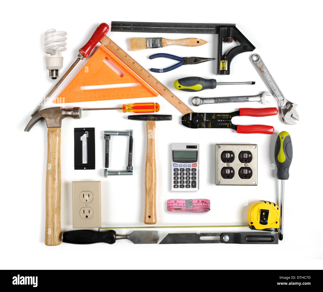 Tools forming a house with energy efficiency chimney - Stock Image