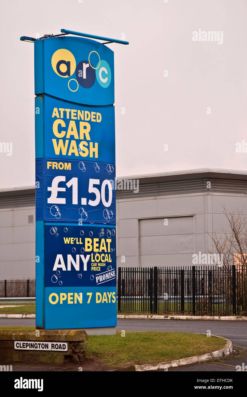 Arc Attended Car Wash Company Sign Advertising That They Are Open 7