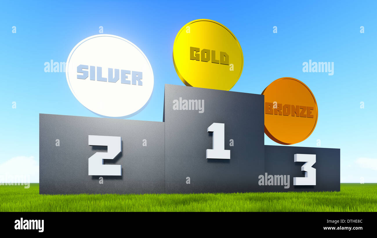 Victory rostrum on the green grass with a golden, silver and bronze medals on top. - Stock Image