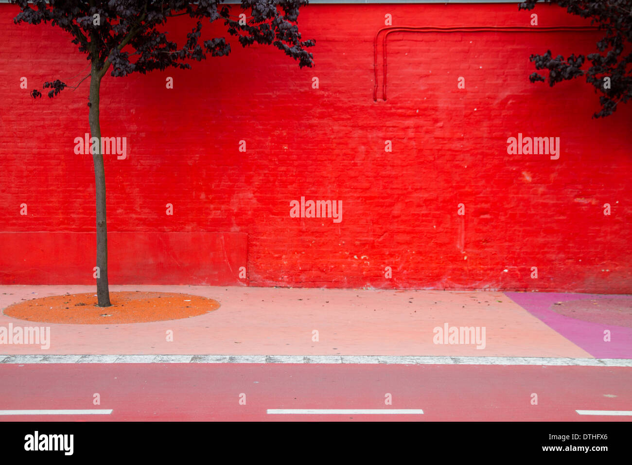 Red wall in Superkilen a public park in the Nørrebro district of Copenhagen, Denmark. - Stock Image