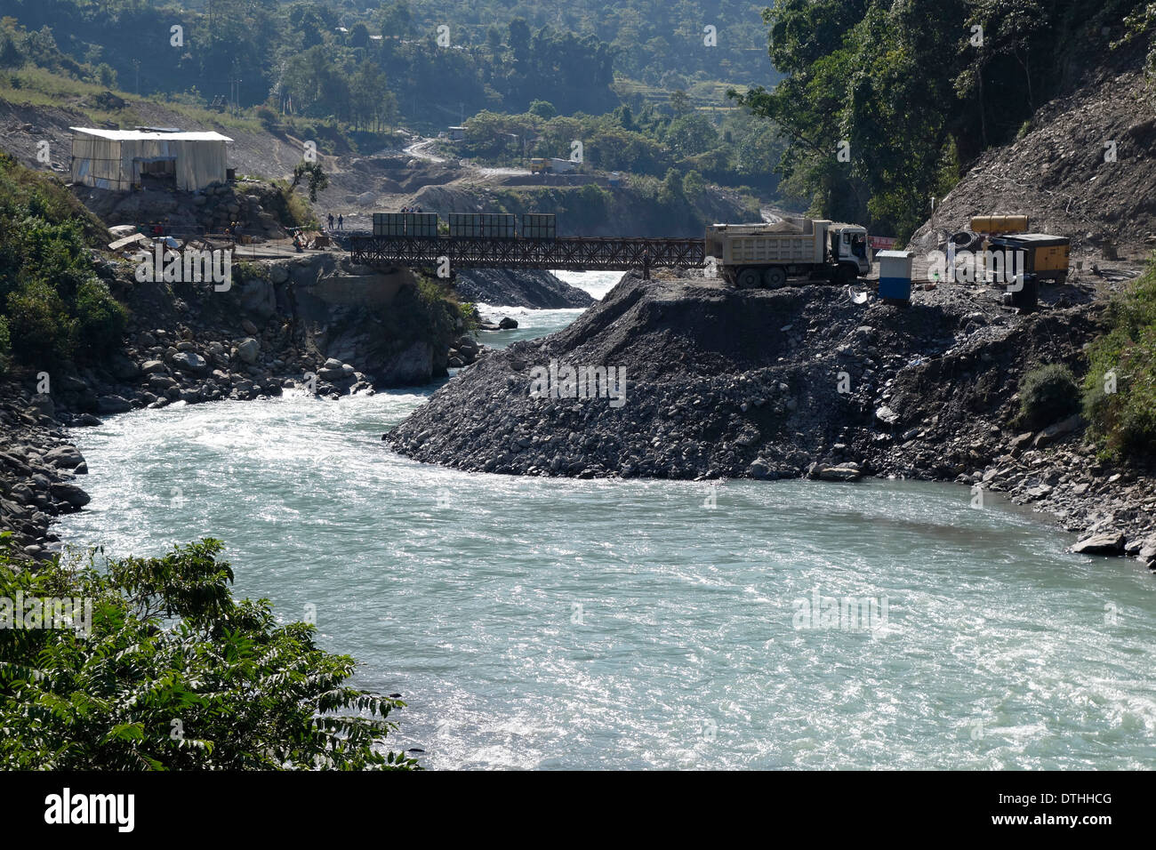 Temporary bridge over the Marsyangdi River in Nepal, part of the controversial Upper Marsyangdi dam project. - Stock Image