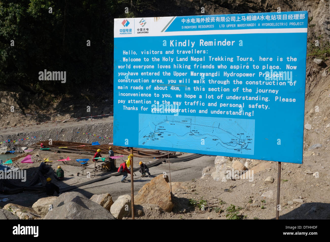 Sign for the controversial Upper Marsyangdi Hydropower Project in Nepal. - Stock Image