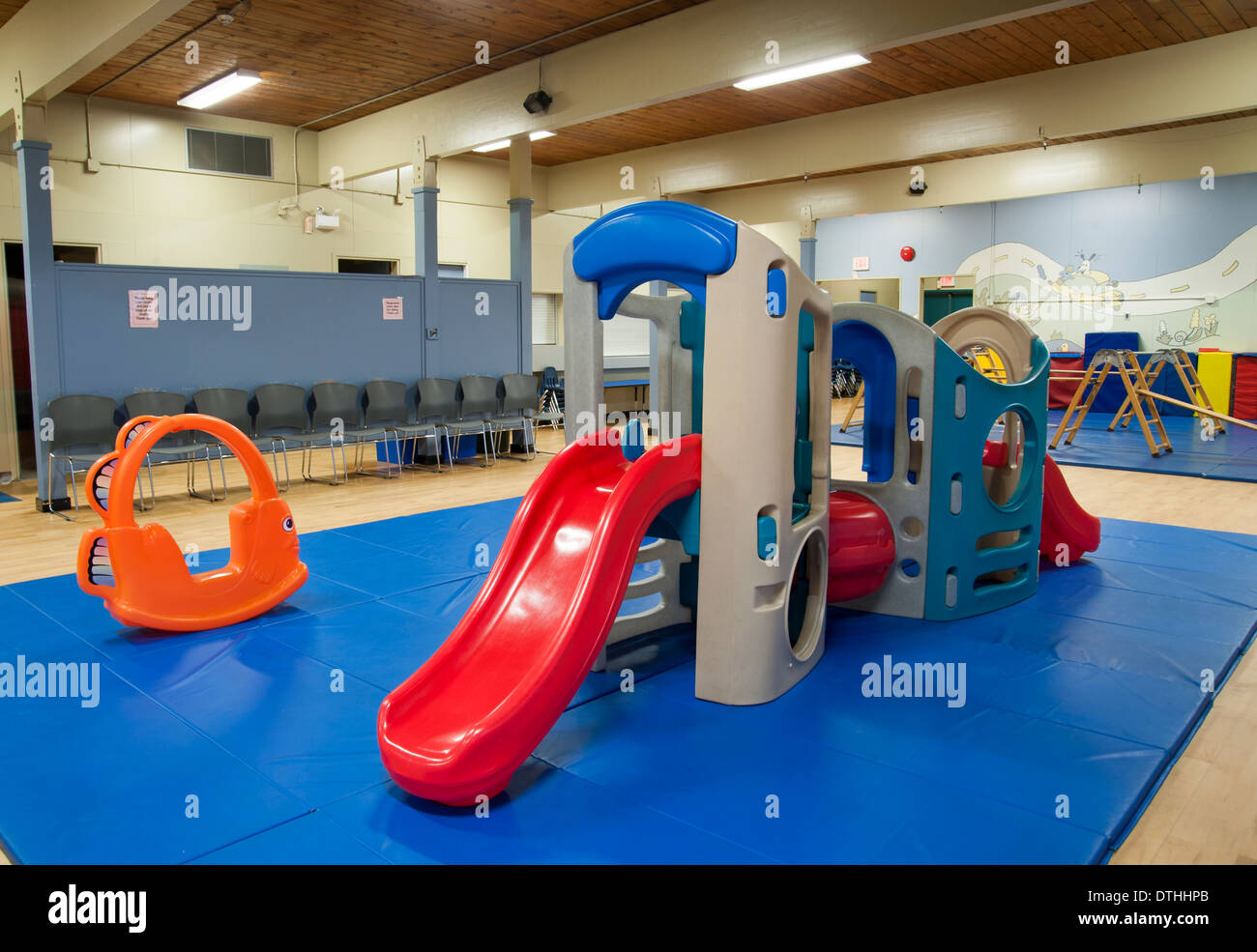 Slide and playground equipment indoors at a daycare centre - Stock Image