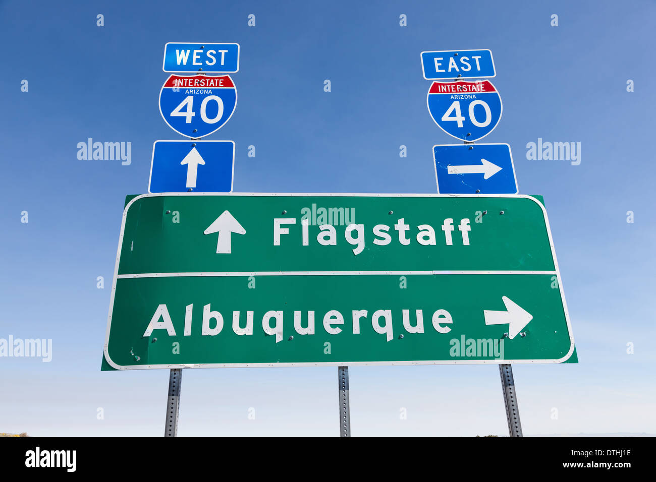 US Interstate I-40 road sign in Arizona with a sky blue