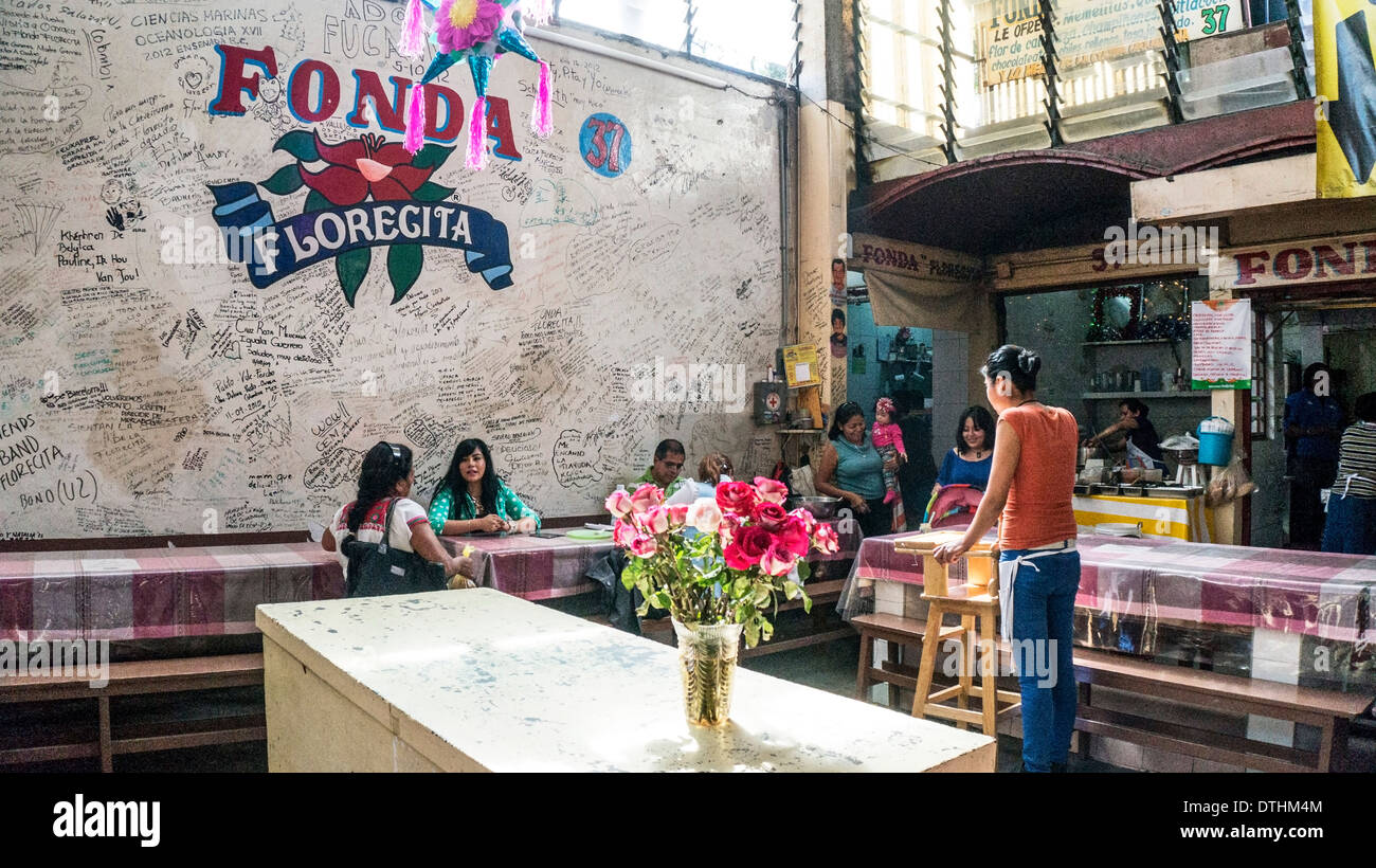 late light on lofty interior of Fonda Florecita restaurant popular with middle class Oaxacans for breakfast & afternoon meal - Stock Image