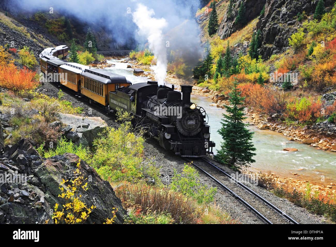 Durango & Silverton Narrow Gauge Railroad, Animas River and Fall colors, near Silverton, Colorado USA - Stock Image