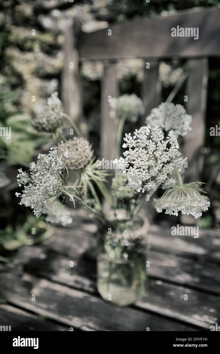 Rustic Flower Arrangements On Location In A Walled Garden