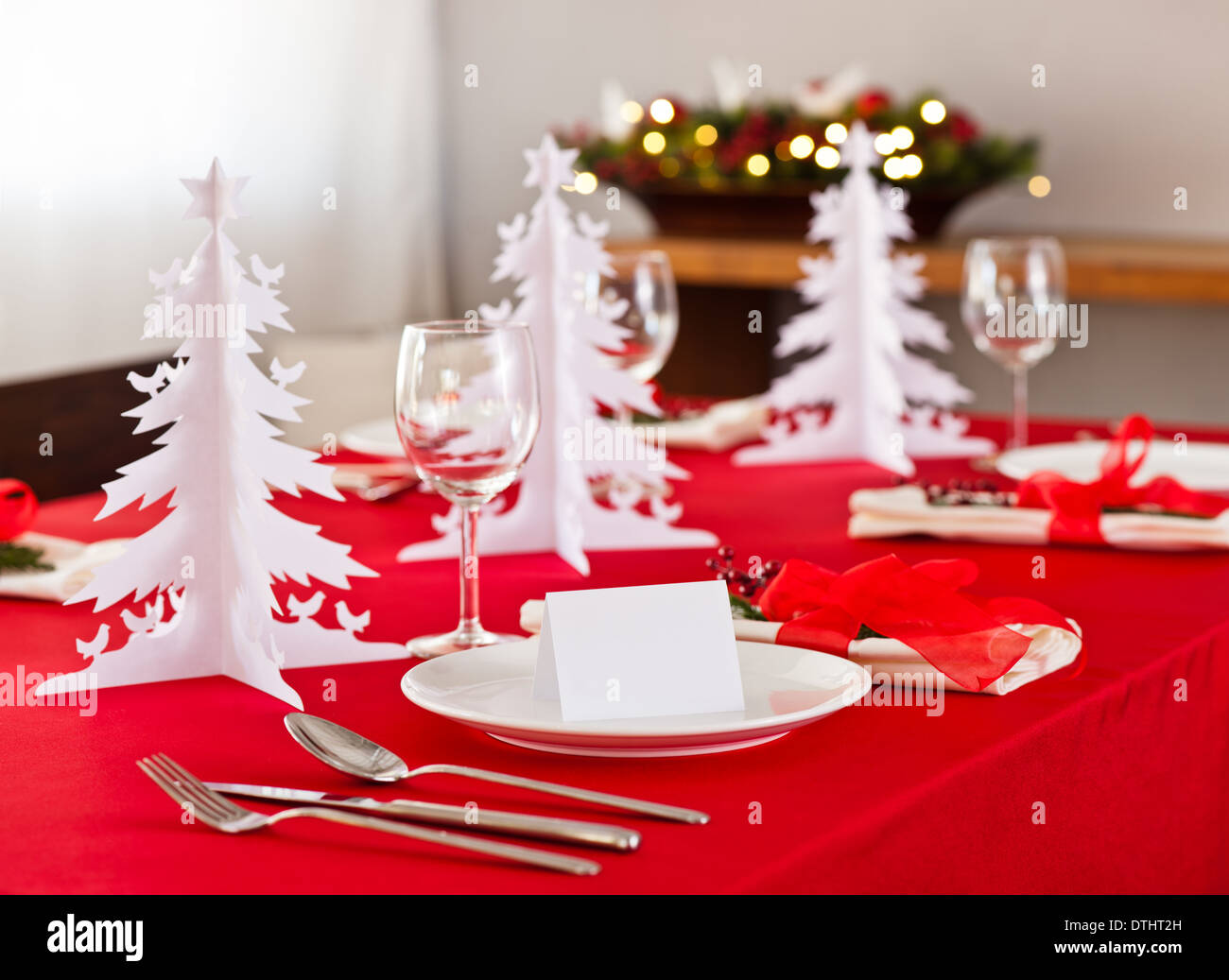 Christmas Dinner Table Setup With Decoration On The Side Board Stock Photo Alamy
