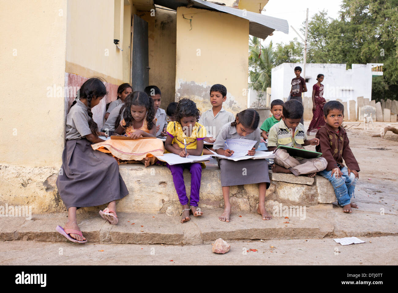 Indian Children Doing School Work Outside A Rural Indian Village House.  Andhra Pradesh, India