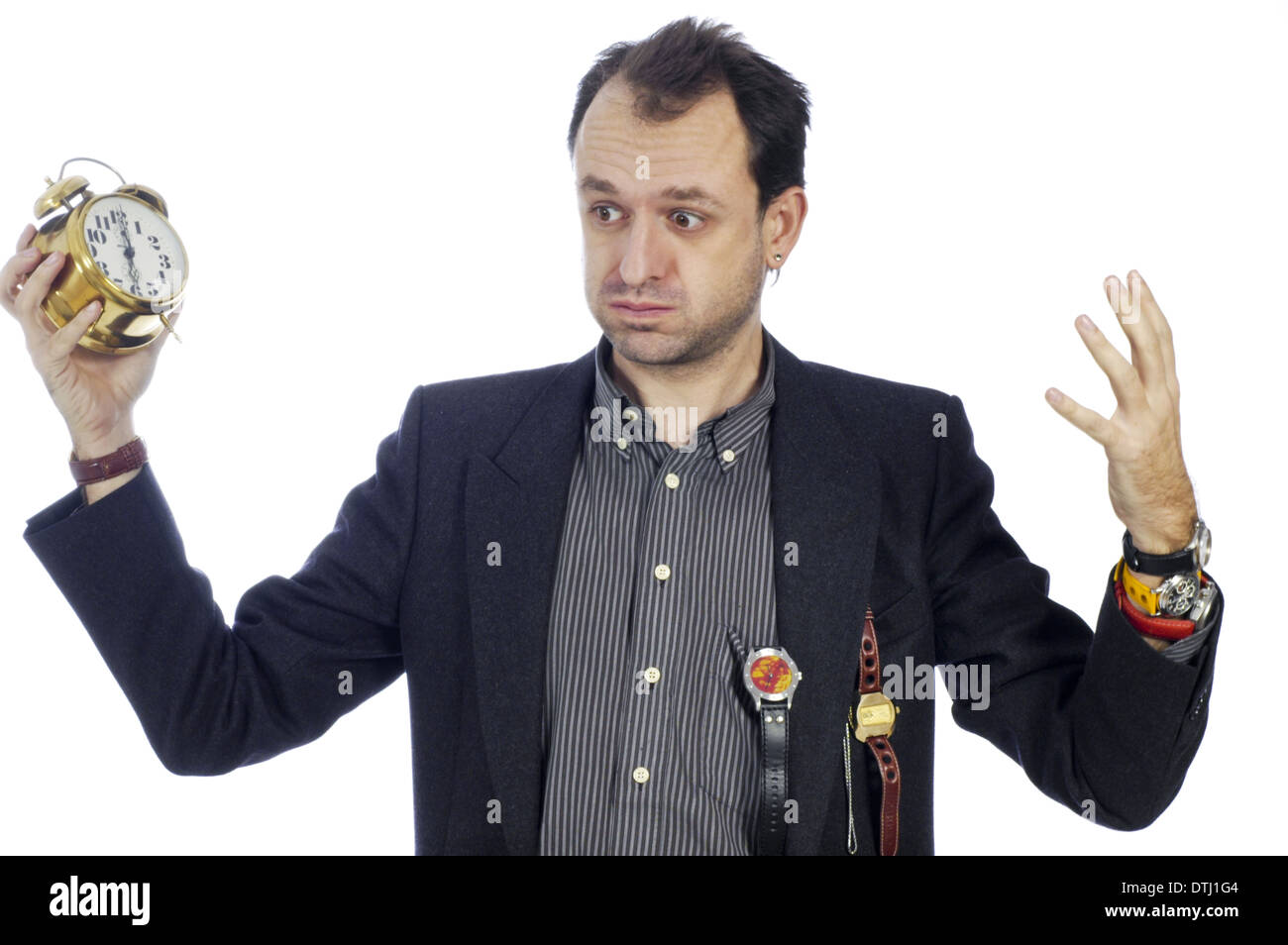 man with wristwatches and alarm clock being stressed out (model-released) - Stock Image