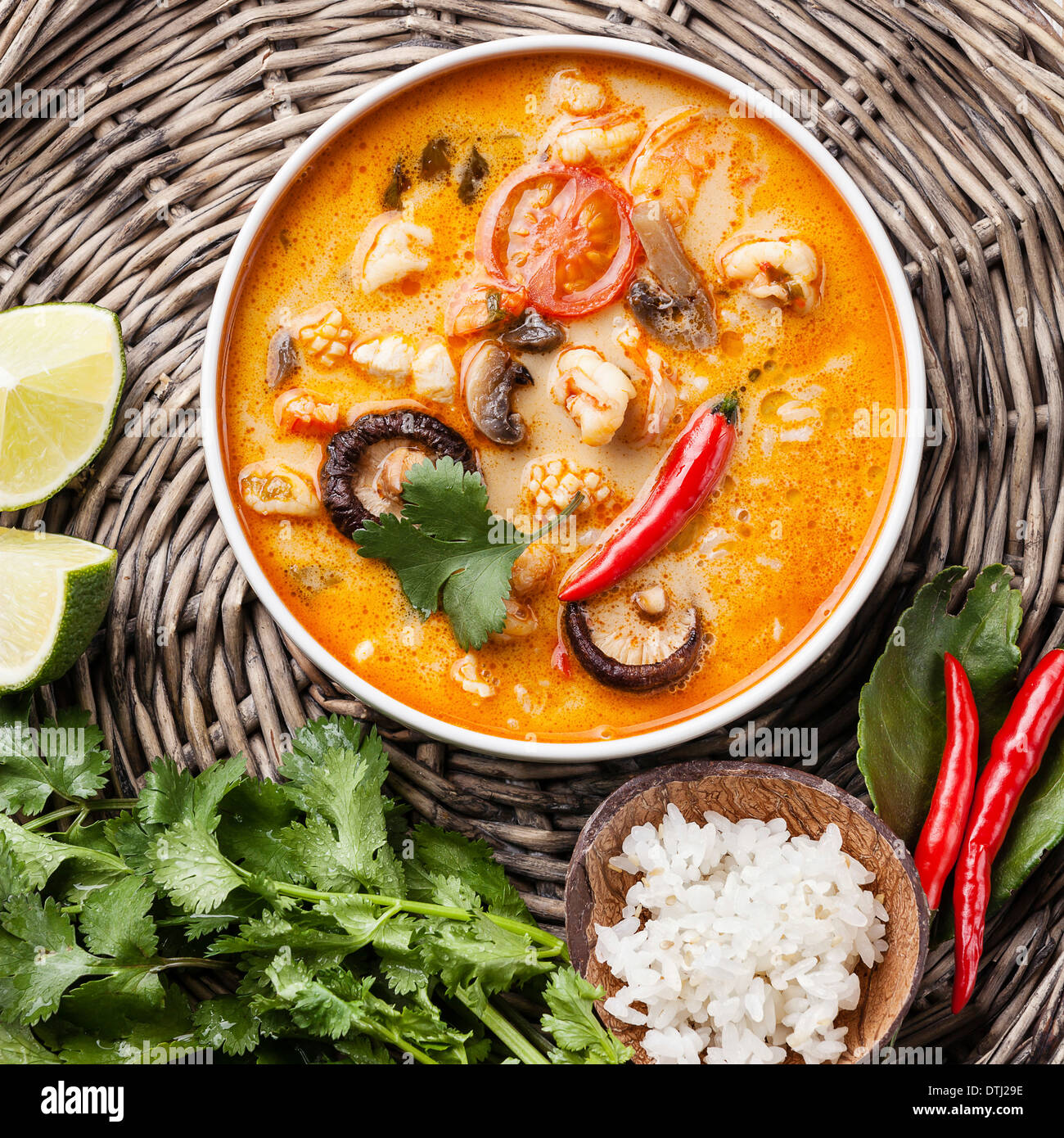 Spicy Thai soup Tom Yam with Coconut milk, Chili pepper and Seafood Stock Photo