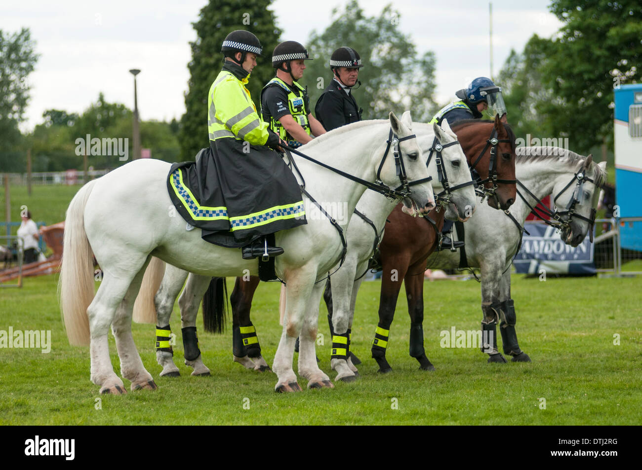 Four British mounted Police Officers on display at a Horse show. - Stock Image