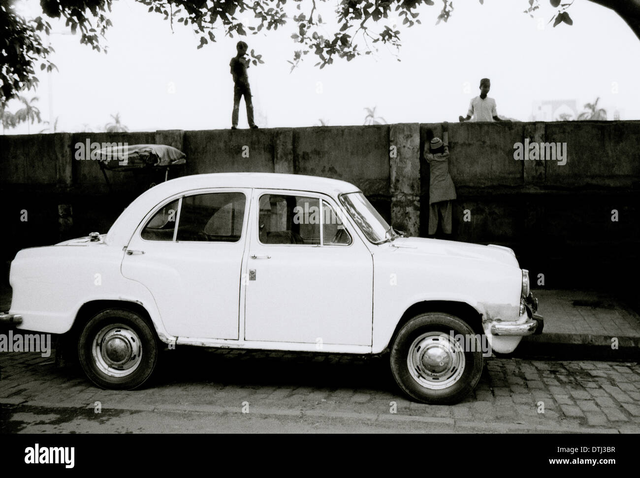 Hindustan Ambassador car in Kolkata Calcutta in West Bengal in India in South Asia. Surreal Surrealism Cars Transport History Indian Travel - Stock Image