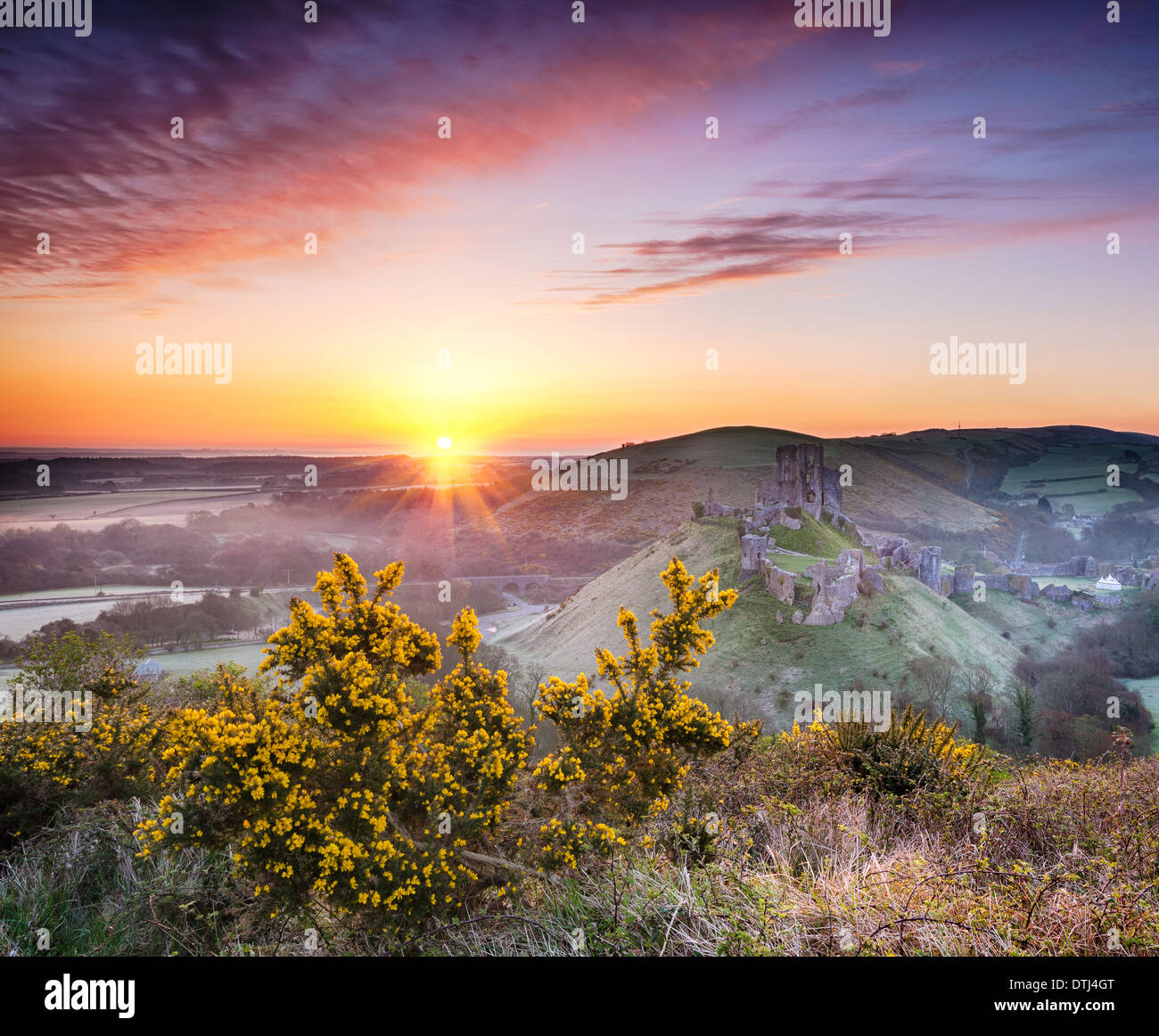 A frosty April sunrise overlooking the ruins of Corfe Castle on the Isle of Purbeck in Dorset - Stock Image