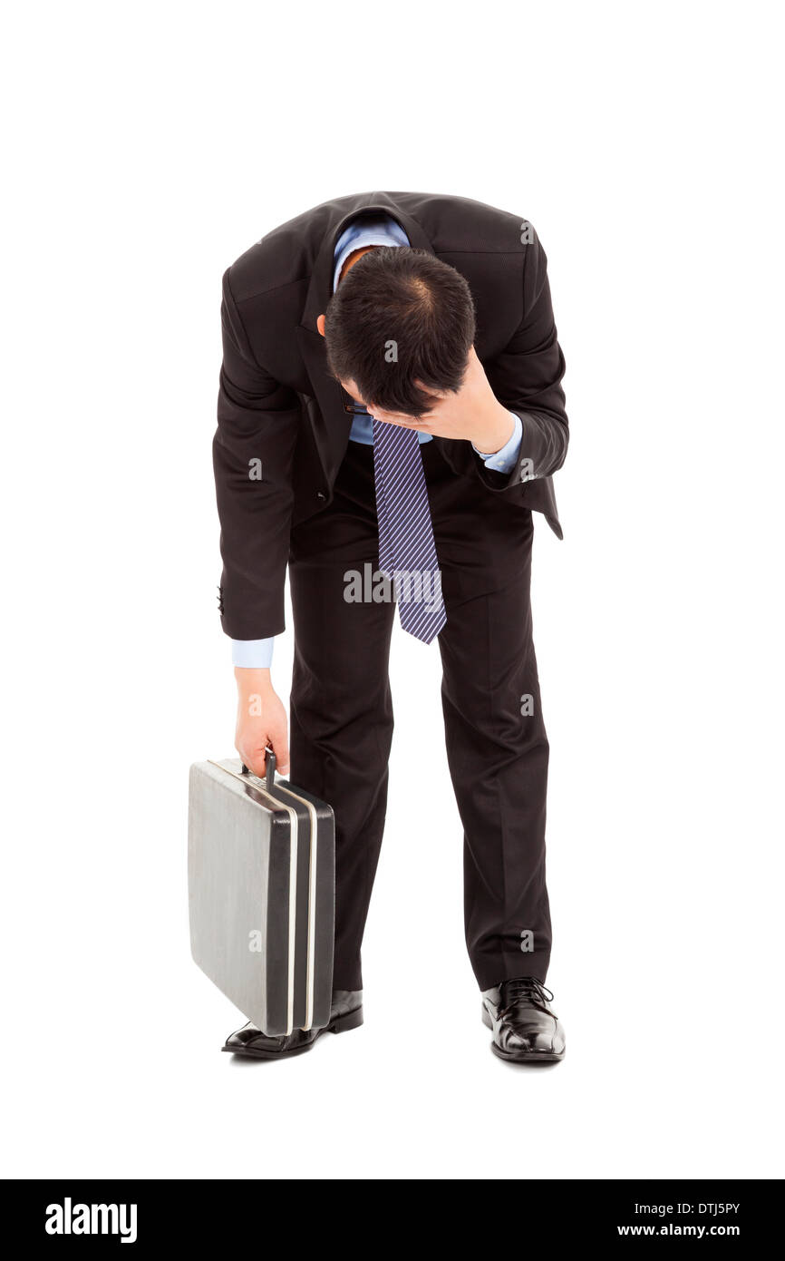afflictive businessman stoop and hold his head over white - Stock Image
