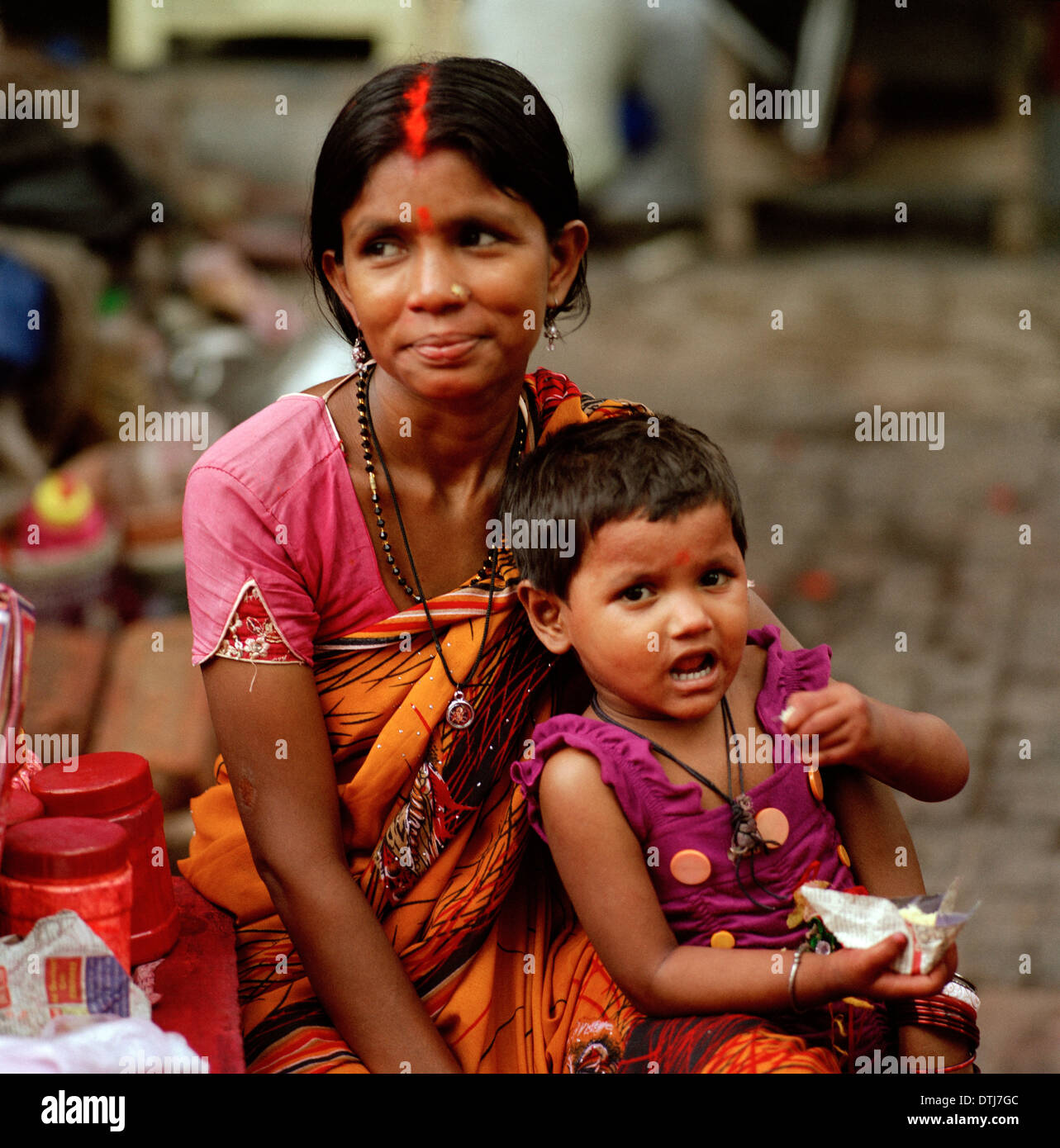 Tikka seller and daughter at Kalighat Hindu Temple in Kolkata Calcutta in West Bengal in India in South Asia. Real Stock Photo
