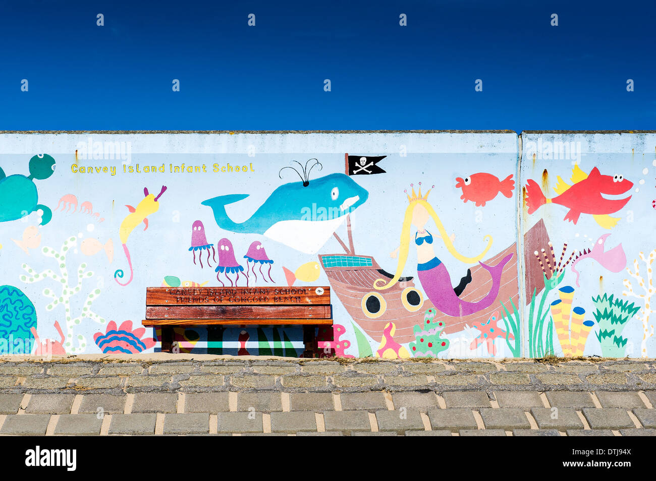 Canvey Island - A colourful mural painted on the sea wall at Canvey Island in Essex. The mural is painted by Canvey Island Infants School. - Stock Image