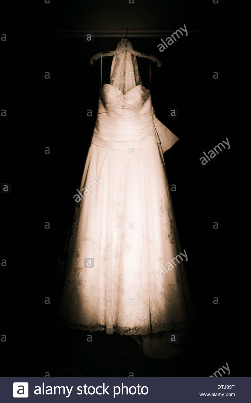 White Vintage Bridal Gown or Wedding Dress Hanging On A Clothes ...