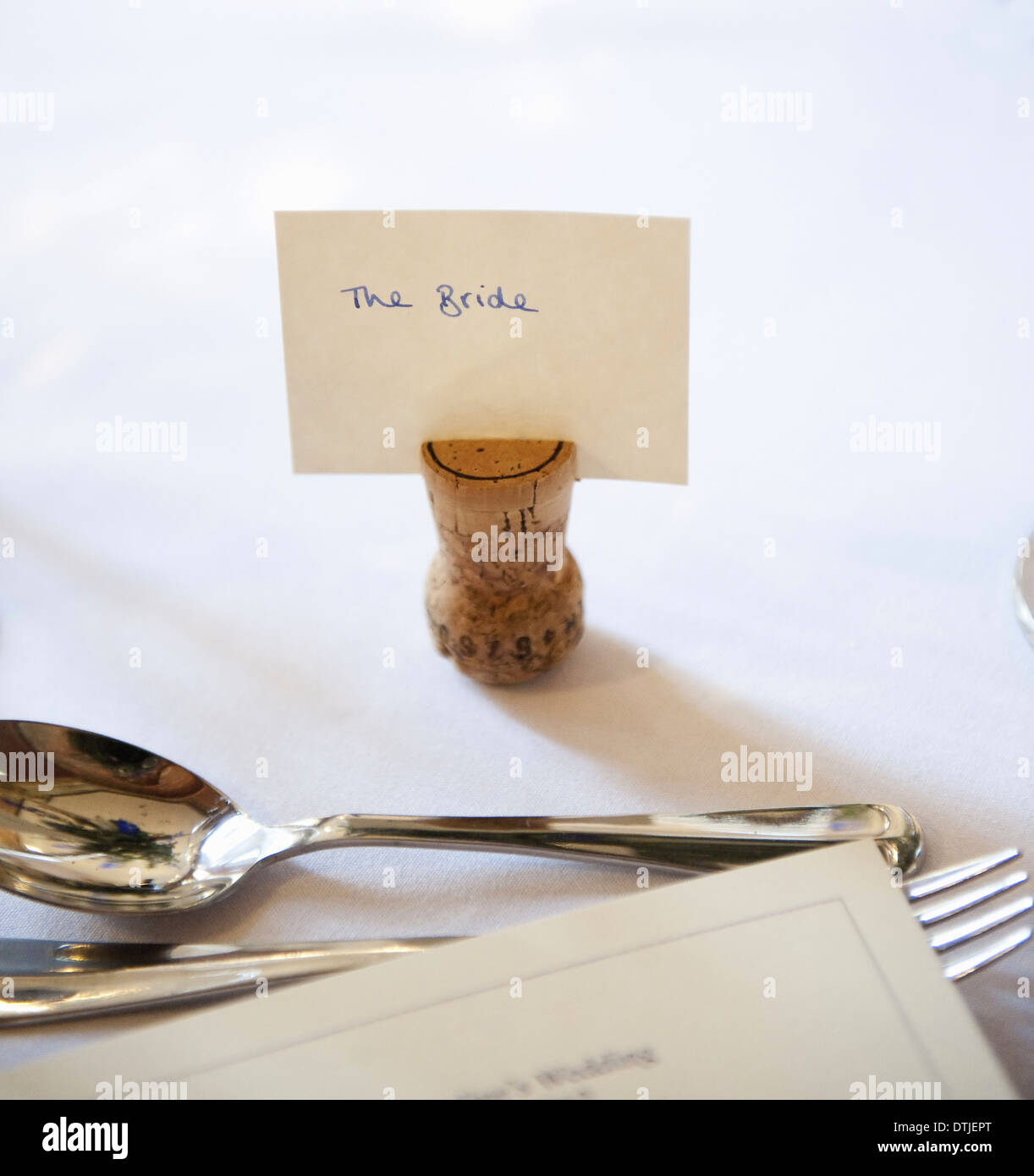 top table at a wedding banquet an upside down cork with a name tag